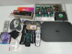 Bag containing Dynamic microphone MD-260, Sky router, remotes, etc