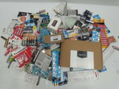 Bag containing loose and packaged batteries in various sizes