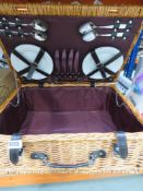 Picnic basket hamper containing plates and cutlery