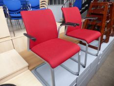 2 Steelcase metal frame and red cloth cantilever chairs