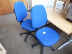 2 blue cloth swivel chairs