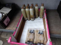 Tray containing eight Ultra Air Players Choice airsoft gas bottles and three blister packs