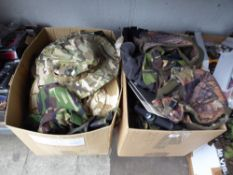 Twop boxes of camo hats etc.