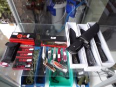 Collection of 'tactical' pocket knives and penknives