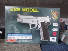 Boxed KWC 226 model 6mm BB airsoft pistol *This Lot is offered for the purposes of historical re-