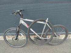 Apollo mountain bike in silver and red with spare wheel and no saddle