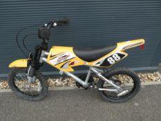 Childs BMX bike in the shape of a motorcrosser
