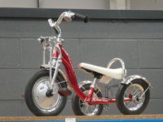 Schwinn tricycle (broken wheel)
