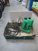 Box containing lawn feed spreader, 2 hanging baskets, shelf and shelf brackets