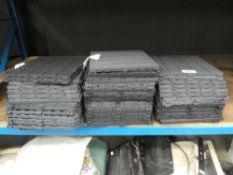 3 stacks of clip together plastic flooring
