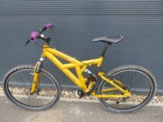 Muddy Fox yellow mountain bike