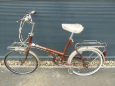 4025 - Brown Raleigh shopper ladies bike