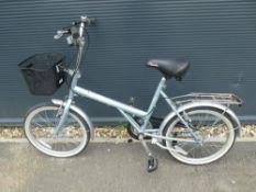 Light blue ladies shopper style bike