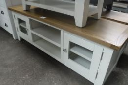 Cream painted oak top TV unit with 2 drawers and 2 glazed doors, 140cm wide (A,24)