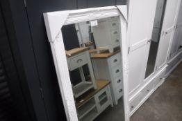 Large white ornate framed bevelled mirror, 75cm wide (B,20)