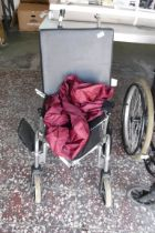 Folding wheelchair with rain cover