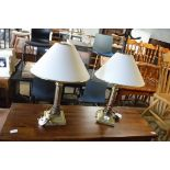Pair of brass table lamps with tapered white shades