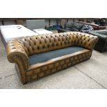 Tan/ mustard yellow upholstered Chesterfield style button back sofa (minus cushions)