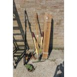 Selection of garden tools incl. rake, wooden garden posts, vice and cobblers lasts