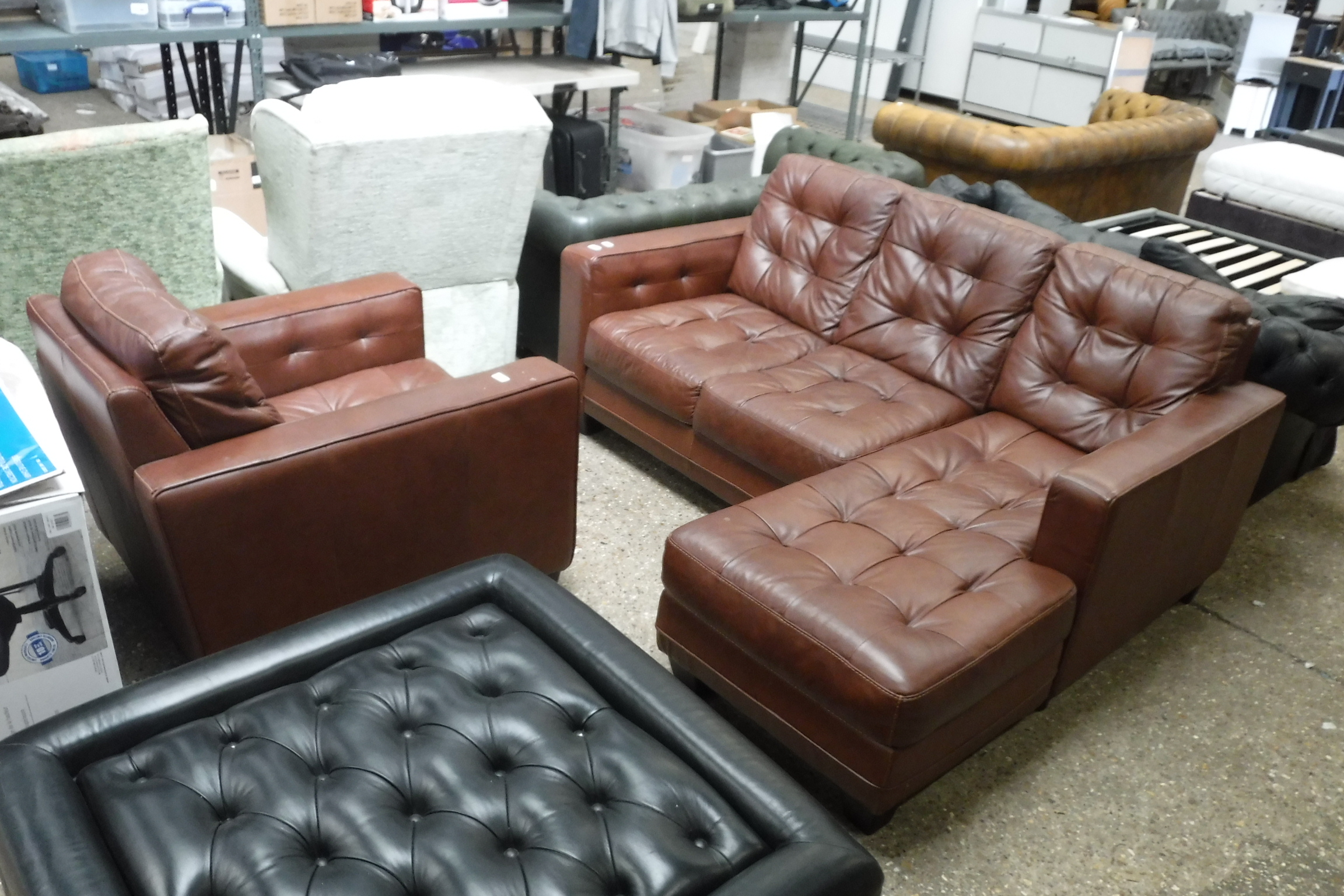 Brown leatherette upholstered lounge suite comprising L-shaped 3 seater sofa and matching armchair