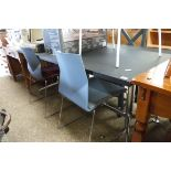 (2035) Modern desk on metal frame with 4 various plastic seated chairs