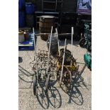 Selection of old agricultural push hoes and metal baskets and assortment of accessories