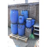 Pallet of blue tubs with lids and 1 dustbin