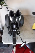 Golf trolley with putter and air of golf shoes, UK 8.5