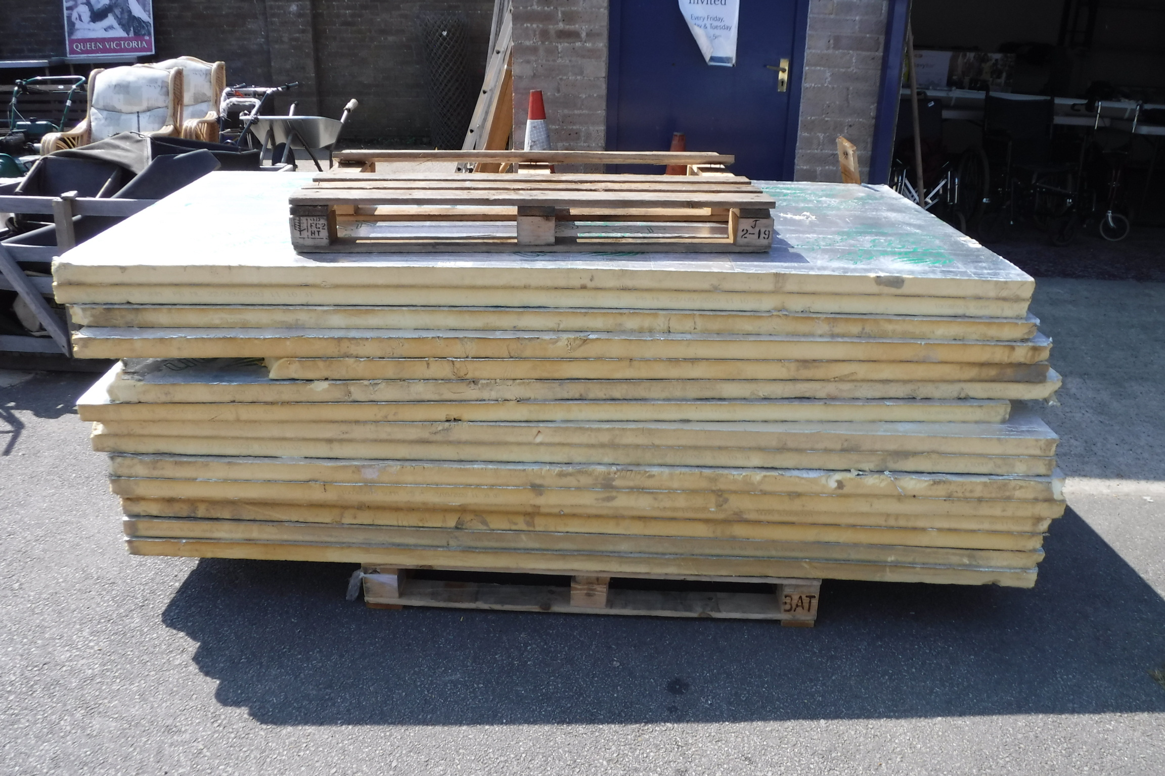 Pallet of various sized insulation boards