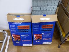 2 boxes containing metal wall racks with plastic bins