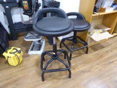 3 black swivel stools