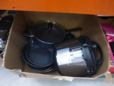 Box containing used pots and pans, and instant pot