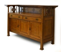 A Commercial Arts & Crafts oak sideboard, the superstructure over two drawers and three drawers,