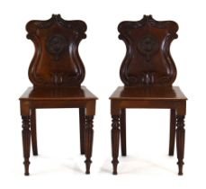 A pair of Victorian mahogany hall chairs, each back bearing insignia for the 3rd Battalian,