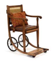 An Edwardian 'Carstairs' wheelchair by J&A Carters Ltd.