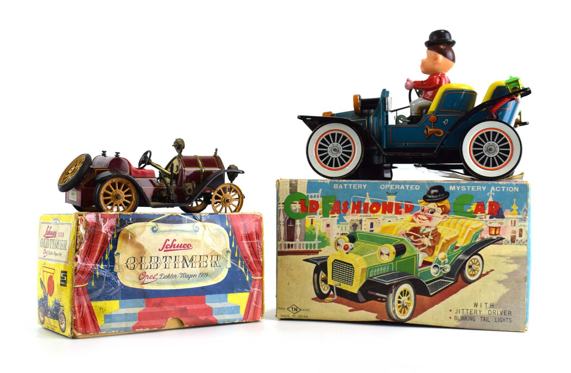 A battery operated Old Fashioned Car and a Schuco 'Oldtimer' vehicle,