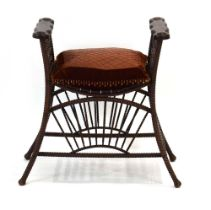 A late 19th/early 20th century carved and bentwood oak stool with rope and barley twist supports,