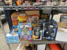 Half shelf of assorted Star Trek, Toy Story and Action Man figures in boxes