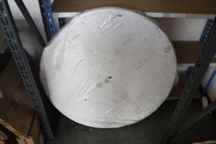 White plastic circular garden table