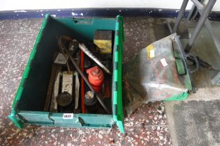 Box containing bottle jacks, trolley jack, green plastic jerry can and pair of jump leads