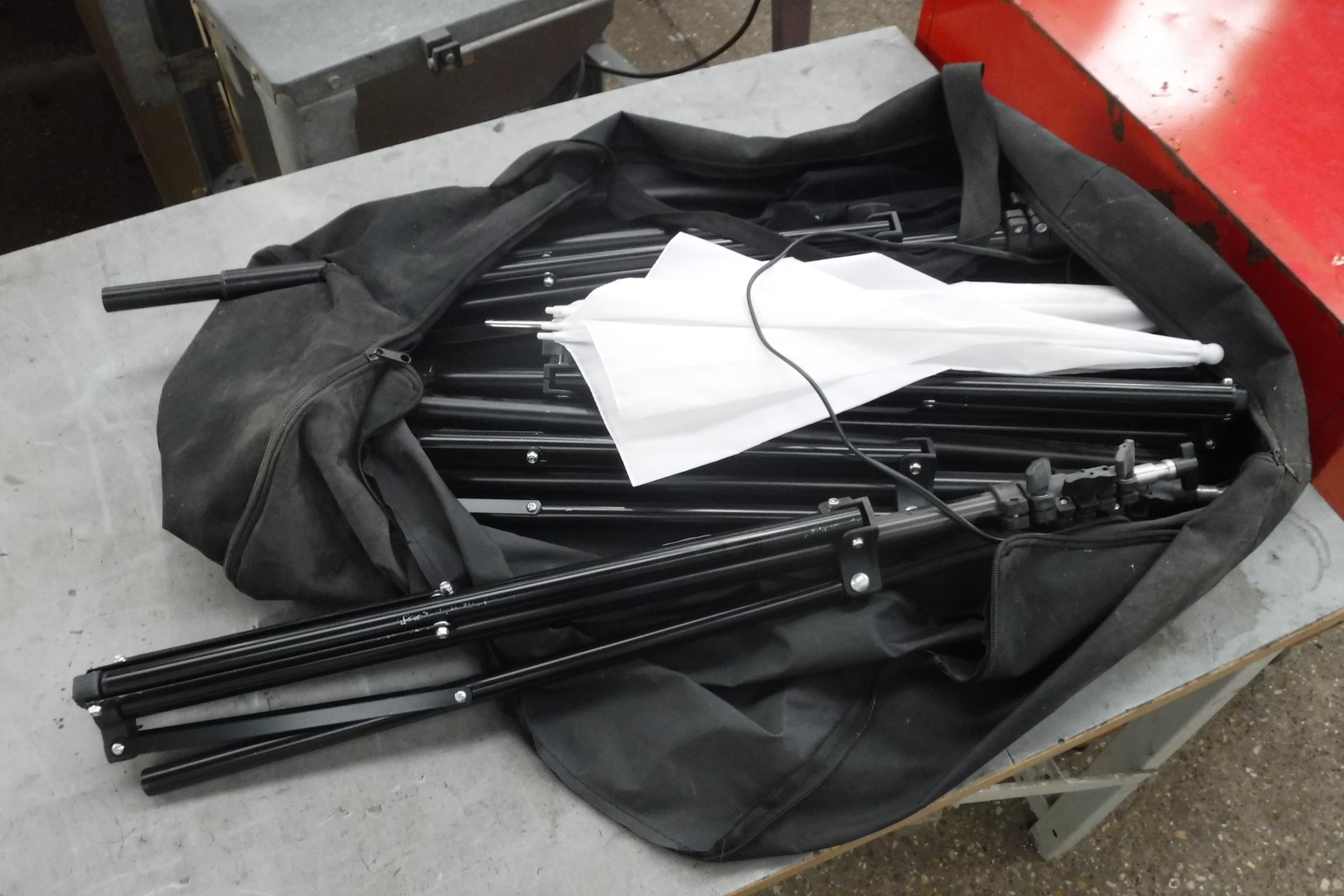 (2360) Tripods and studio umbrellas in bag