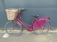 Cerise ladies bike with front basket