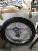 2 motorcycle wheels and tyres