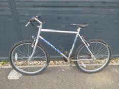 Silver and blue Saracen mountain bike
