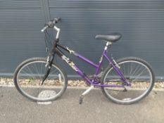 Purple and black Raleigh ladies bike