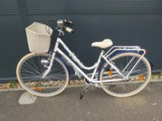 White and blue ladies bike with front basket