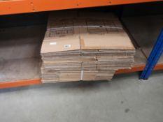 2 bundles of flat pack cardboard boxes