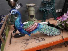 Metal garden peacock