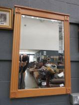 Rectangular bevelled mirror in oak frame