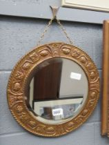 Small circular bevelled mirror in gold painted metal frame